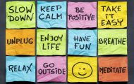 post it notes with slow down, relax, take it easy, keep calm and other motivational lifestyle reminders on colorful sticky notes
