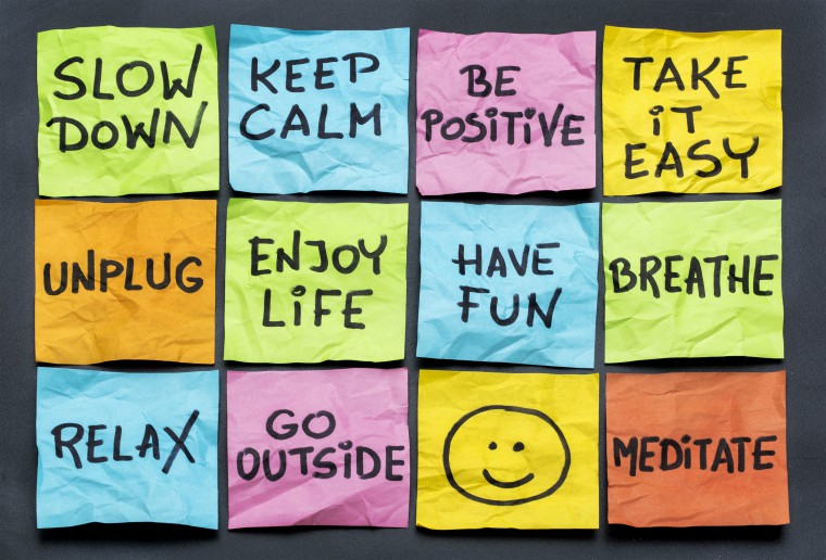 post it notes saying slow down, relax, take it easy, keep calm and other motivational lifestyle reminders
