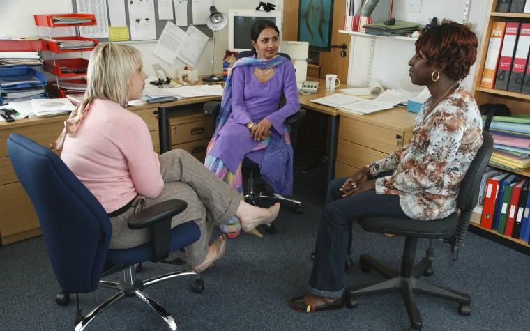 social workers in office meeting