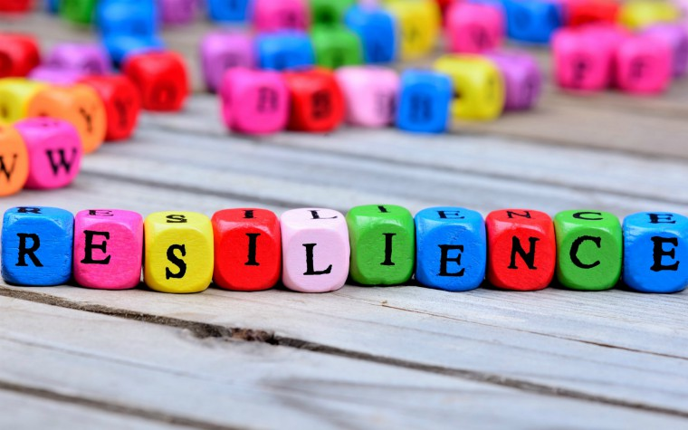 The word resilience spelt out on multi-coloured cubes