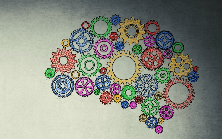 Conceptual image of brain with multicoloured cogs