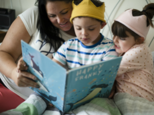 disabled child and family reading story