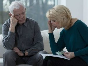 description_of_image_used_in_safeguarding_adults_piece_troubled_couple_affected_by_financial_abuse_fotolia_Photographee.eu