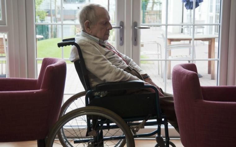 older man alone in wheelchair