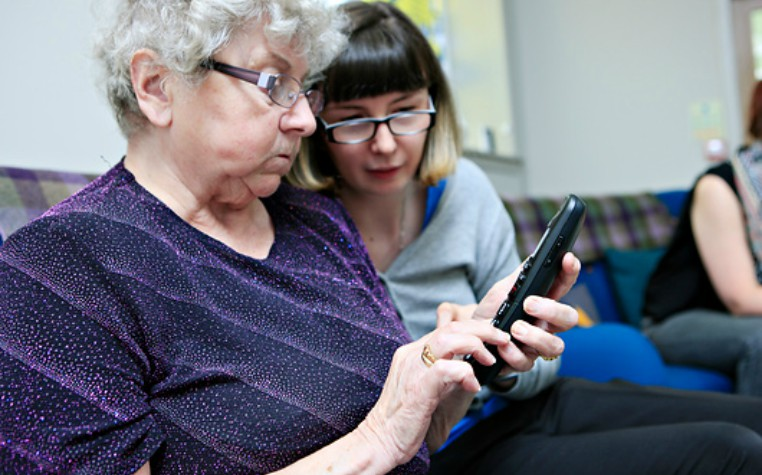 advocate supporting service user with a telephone