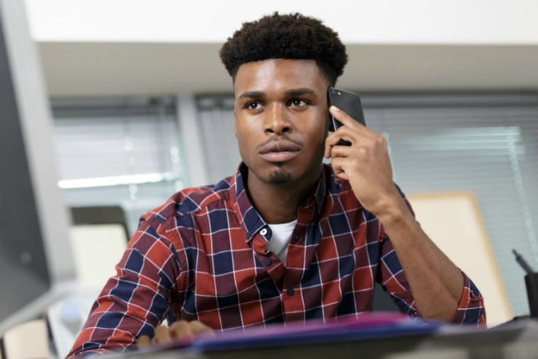 young black male on phone
