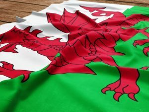 Flag of Wales on a wooden desk background