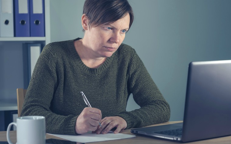 Woman working at desk.