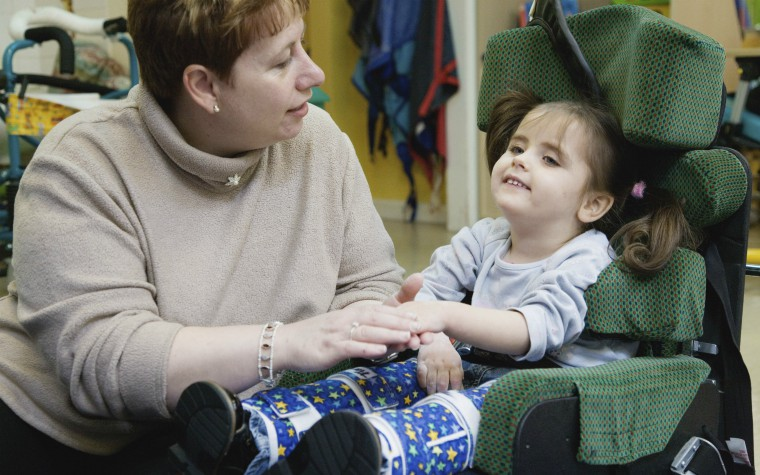 carer with child with multiple disabilities