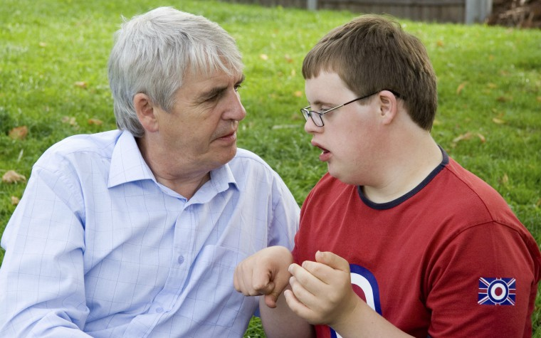 father talking to teenage son with down's syndrome John Birdsall Social Issues Photo Library Science Photo Library 760
