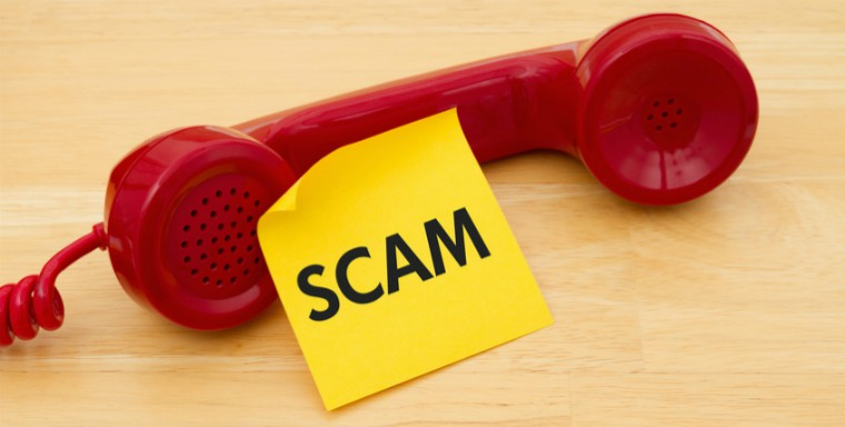 description_of-image_used_in_scam_guide_phone_with_scam_note_Karen_Roach_Fotolia