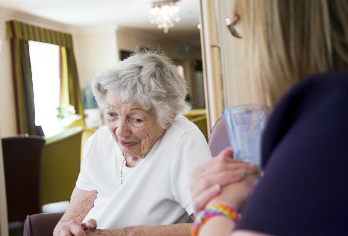 older woman meeting social worker