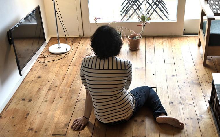 woman sitting on the floor