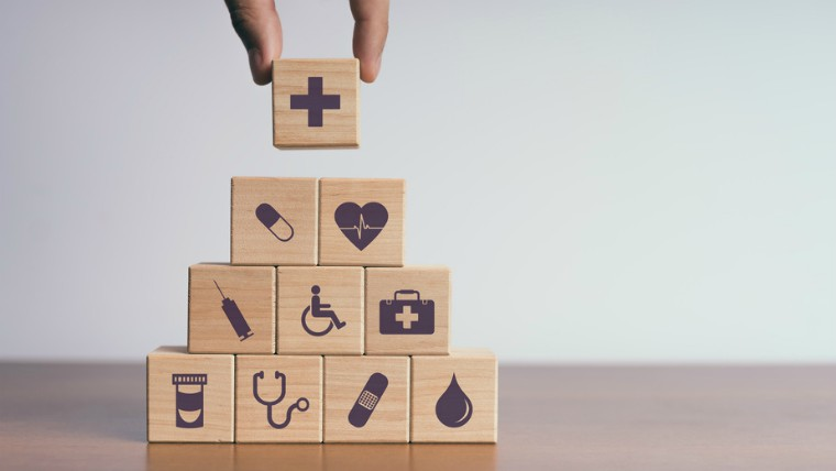 Wooden building blocks with health symbols