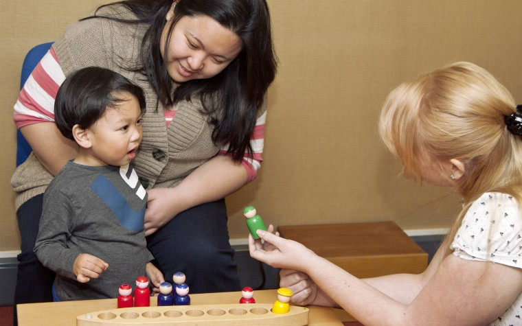 child development tests with parent and social worker