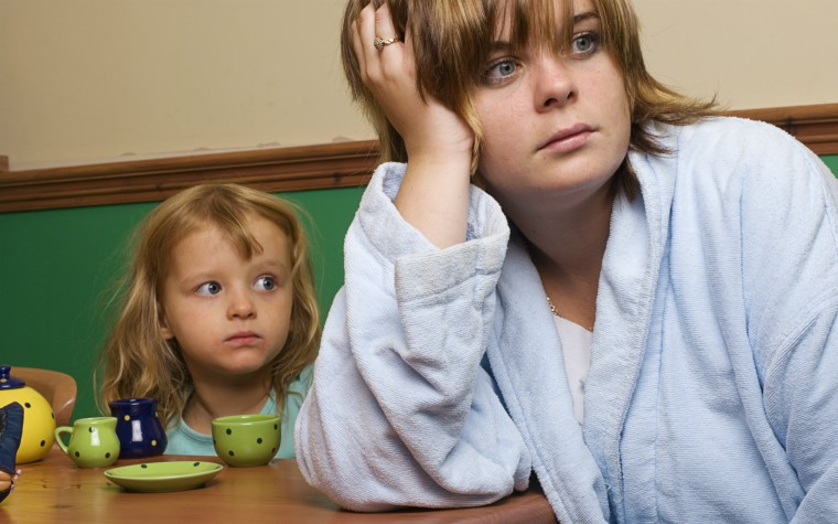neglected child looking at distracted mother