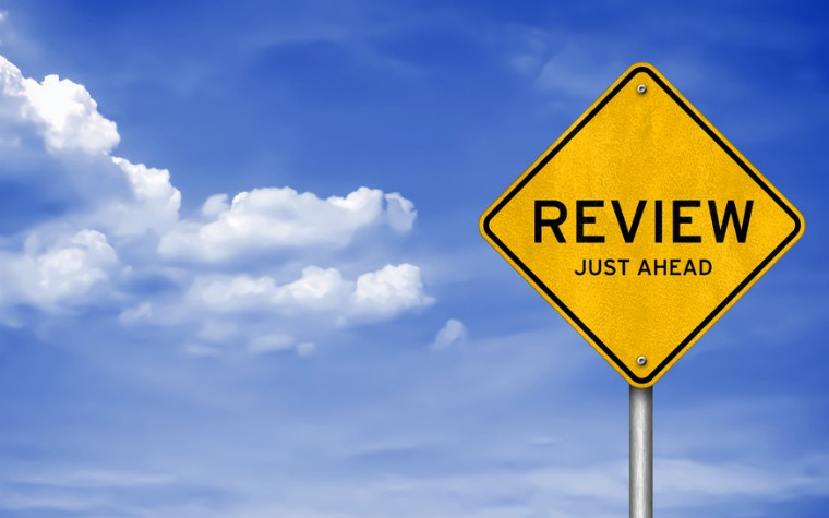 yellow road sign saying review just ahead