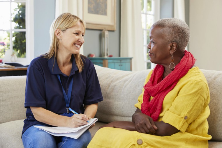 Female social worker visiting older person at home