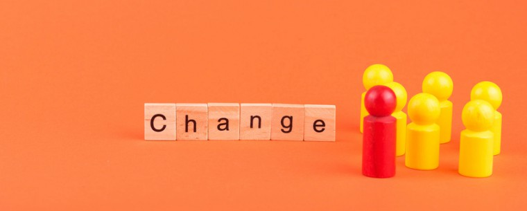 The word 'change' in wooden blocks and plastic figures