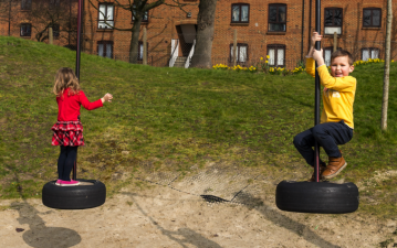 siblings children park playing
