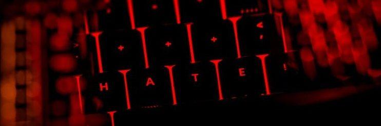 The word 'hate' illuminated on keyboard (cyberbullying)