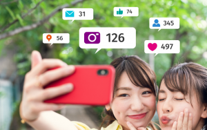 Teenagers posing for selfie, like and followe symbols and numbers pop up