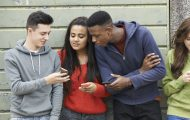 Group of teenagers looking at mobile phone