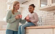 Foster care and child sitting in the kitchen