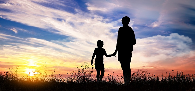 Mother with son observes the sunset