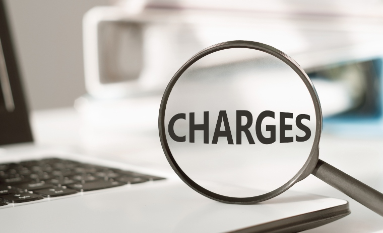 magnifying glass with the word 'charges' inside