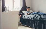 Teenage boy in bedroom