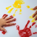 description_of_image_used_in_children_act_legislation_child_hand_prints_with_paint_martinlee_rex_shutterstock