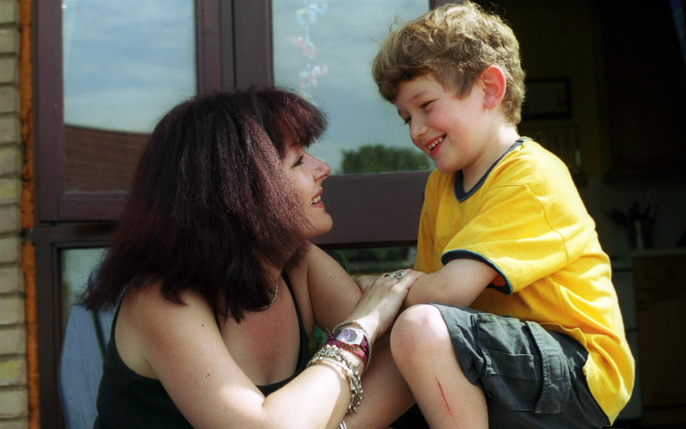 description_of_image_used_in_adoption_support_services_happy_adoptive_mother_and_child_having_a_discussion_together