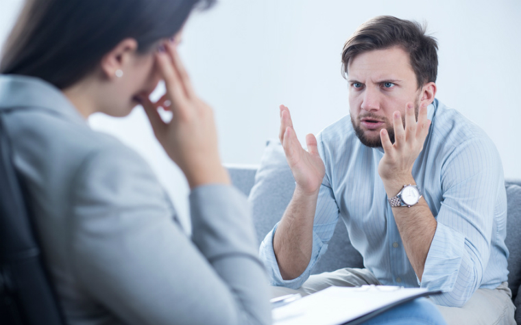 description_of_image_used_in_working_with_hostile_and_aggressive_clients_man_angry_with_female_social_worker