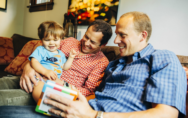 description_of_image_used_in_adoption_by_same_sex_couples_two_fathers_reading_with_their_young_son