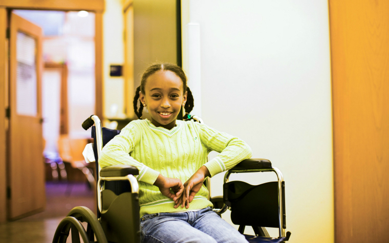 description_of_image_used_in_one_page_profiles_smiling_girl_in_a_wheelchair