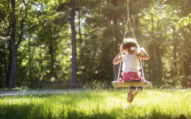 Description_of_image_used_in_children_and_families_legislation_girl_playing_on_swing_BlendImages_REX_Shutterstock