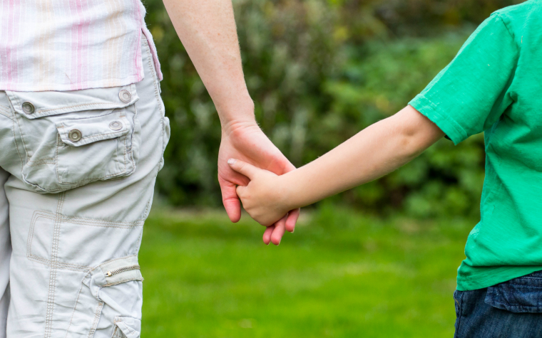 Description_of_image_used_in_webinar_attachment_how_to_use_theory_more_confidently_parent_and_child_holding_hands