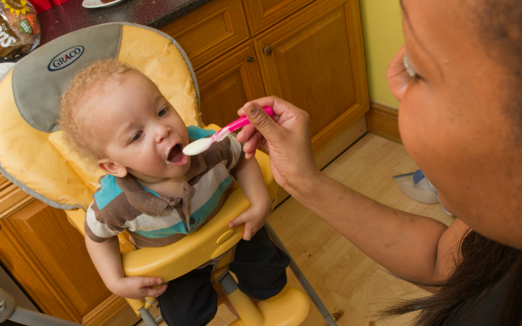 Description_of_image_used_in_adoption_outside_resources_toddler_being_fed