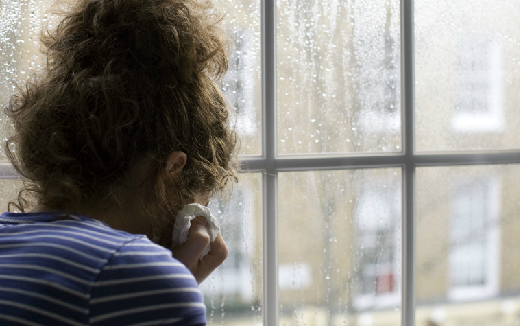 Description_of_image_used_in_female_genital_mutilation_fgm_knowledge_and_practice_hub_girl_crying_window_rain