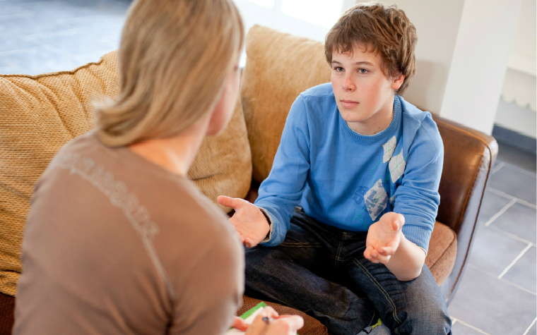 description_of_image_used_in_working_with_advocates_quick_guide_teenage_boy_talking_to_advocate_burger_phanie_rex_shutterstock