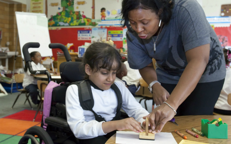 Teacher and child in wheelchair