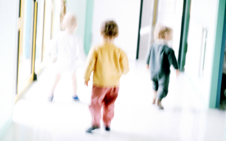 Description_of_image_used_in_residential_care_outside_resources_young_children_in_hallway