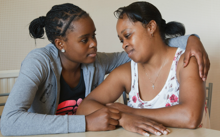 Description_of_image_used_in_young_carers_outside_resources_young_woman_comforting_mother