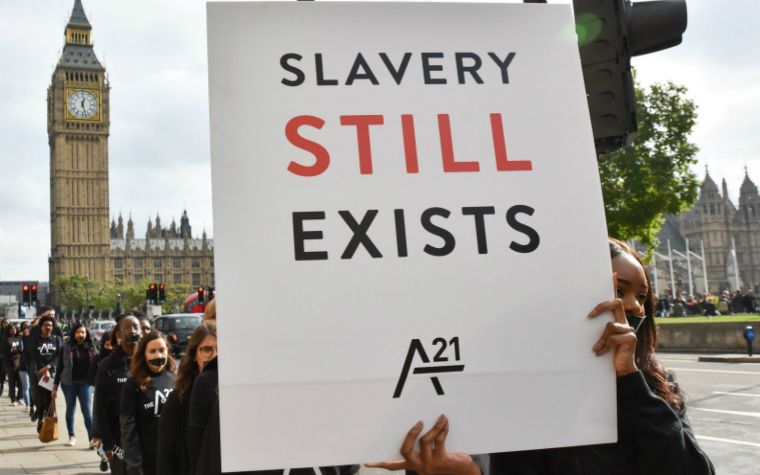 Description_of_image_used_in_guide_to_modern_slavery_slavery_still_exists_protest