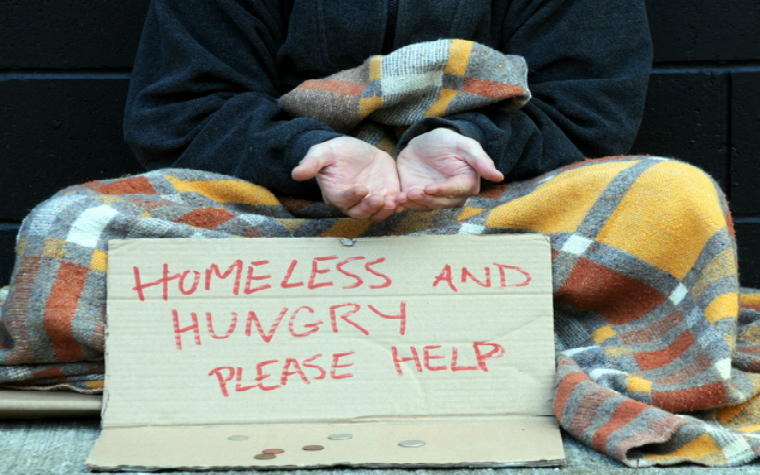 Description_of_image_used_in_homelessness_guide_homeless_person_hungry_sign