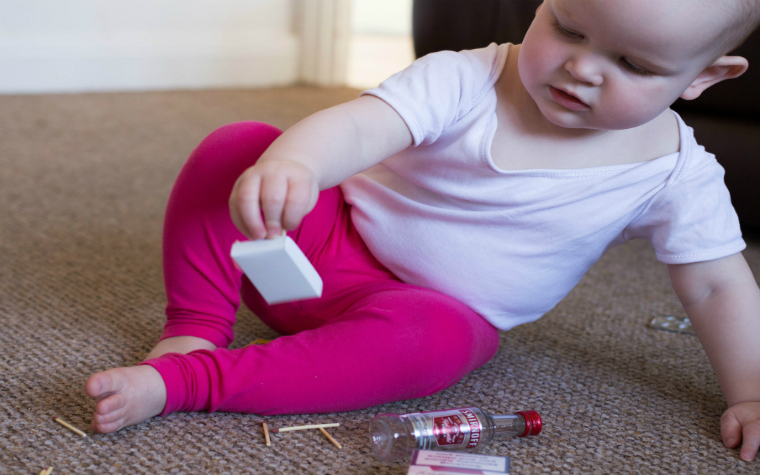 Description_of_image_used_in_what_makes_child_vulnerable_to_neglect_quick_guide_child_playing_with_dangerous_objects_left_alone