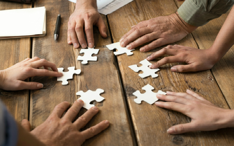 Description_of_image_used_in_foster_carers_roles_and_responsibilities_quick_guide_hands_jigsaw
