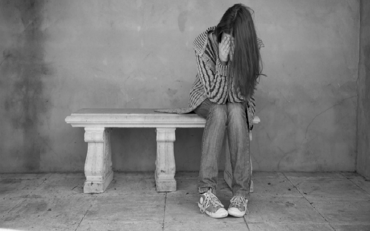 Description_of_image_used_in_child_sexual_exploitation_key_terms_concepts_girl_looking_depressed