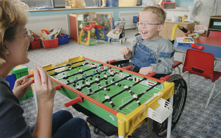 Description_of_image_used_in_working_with_physically_disabled_children_disabled_child_playing_table_football